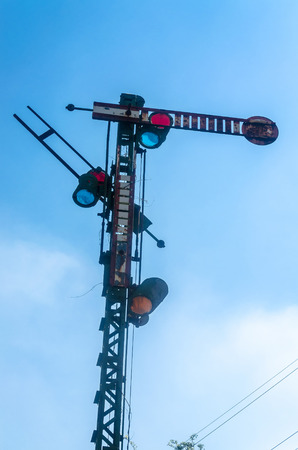 electronically: Old railway signal. The signals regulate visually, acoustically or electronically train services.