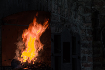 forge: Embers and flame from a forge Stock Photo