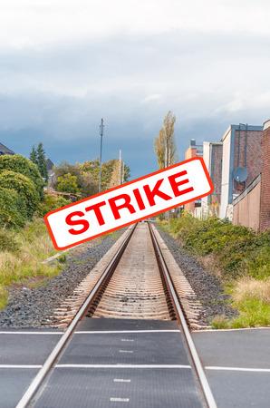 protest sign: Railway strike, empty tracks. Seemingly endless railway tracks with a protest sign. With labeling, strike.
