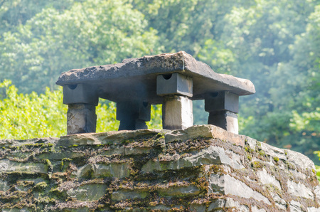 sweeps: Old brick chimney with stone slabs cover. Stock Photo