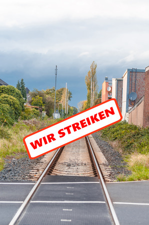 seemingly: Railway strike, empty tracks. Seemingly endless railway tracks with a protest sign. With labeling, strike.