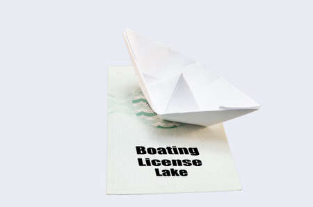 multiple choice: Document from the German boat driving license lake. With small paper ship as a symbol. Stock Photo
