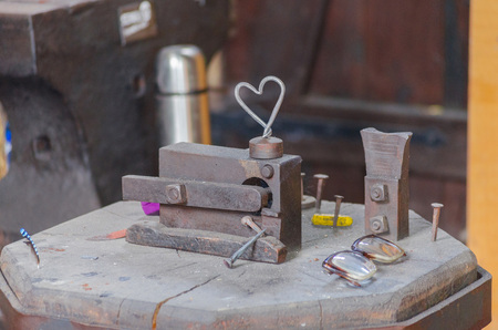 wood tick: An old abandoned locksmith shop. Pictured anvil and different tools and objects. Stock Photo