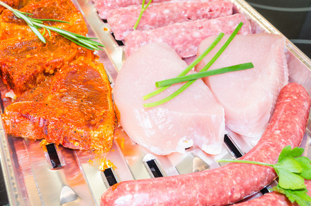 meats: Close up various meats seasoned ready to grill.