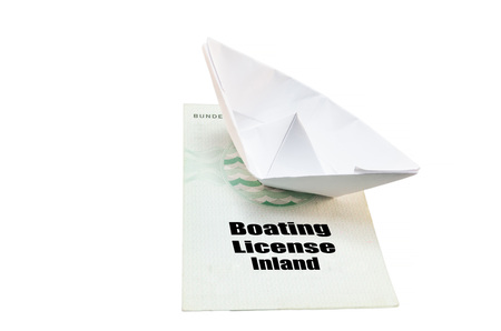 auditors: Document from the German boat driving license inland. With small paper ship as a symbol. Stock Photo