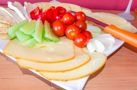 cheese platter: Cheese platter with fruits and vegetables  cheese plate garnished.