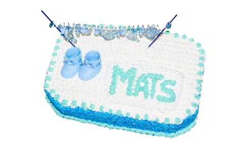 Garnished children birthday cake with icing, inscription and little baby shoes. Stock Photo