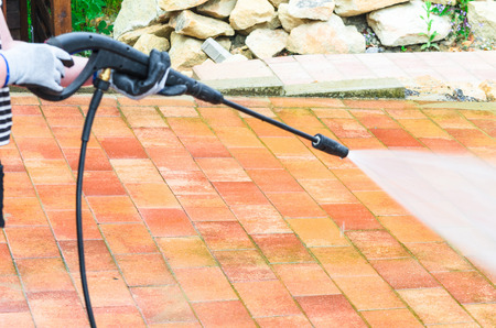 water jet: Outdoor floor cleaning and building cleaning with high pressure water jet. Stock Photo