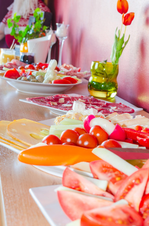 private party: Buffet for a private party with salads and finger food on a cabinet.