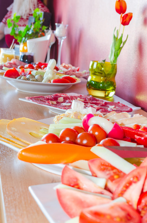 private party: Catering, Buffet for a private party with salads and finger food on a cabinet.