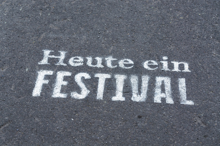 festival moments: Today a festival marked on a tarmac road in blue. Stock Photo