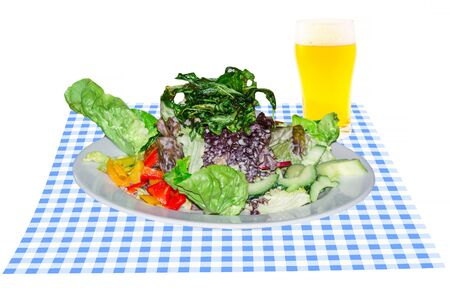 white blanket: Bavarian vegetarian food from above. Salad with beer on blue white blanket.