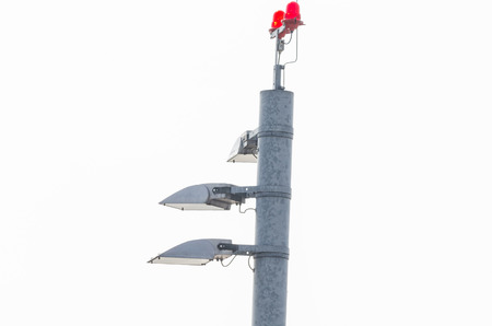 lighting fixtures: Tower at an international airport with lighting, landing lights. The lights are used for air traffic control.