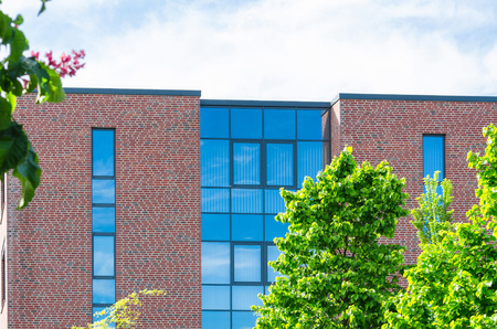 corporate building: Property picture of a modern office building with beautiful glass front. Stock Photo