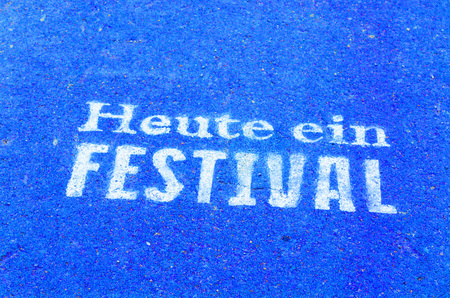 festival moment: Today a festival marked on a tarmac road in blue color.