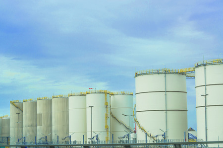 fuel tanks: Several large white industrial fuel tanks for petrol and oil