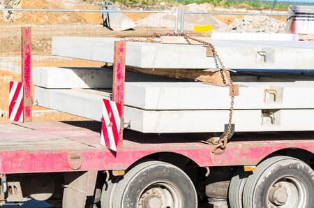 precast: Tractor-trailer with precast concrete elements for prefabricated houses. Stock Photo