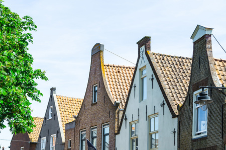 house gable: Cityscape of various Dutch building facades.