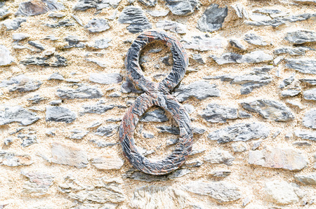 anno: Old castle stone wall with speed Nr. 8 in wrought iron. texture background