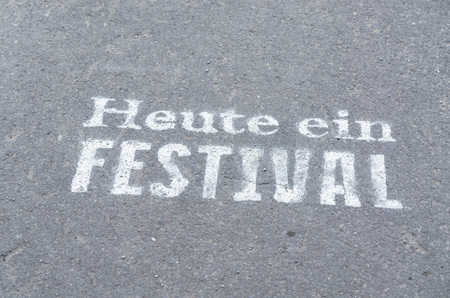 current events: Today a festival marked on a tarmac road in white color.