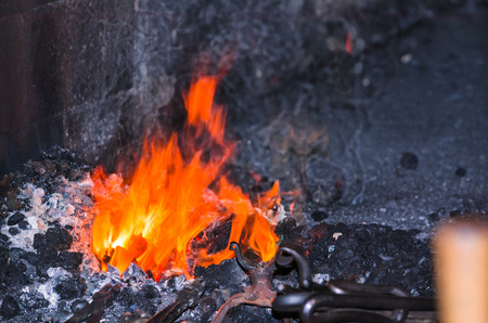 forge: Embers and flame of a glowing red forge fire Stock Photo