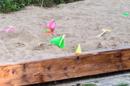 plastic toys: Big sandbox with different plastic toys. Stock Photo