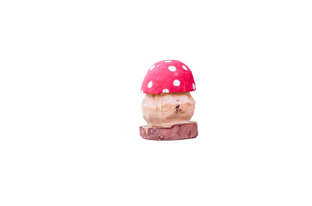 'fly agaric': Fly agaric manufactured from wood against white background.
