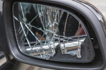 broken contract: Damaged broken car mirrors