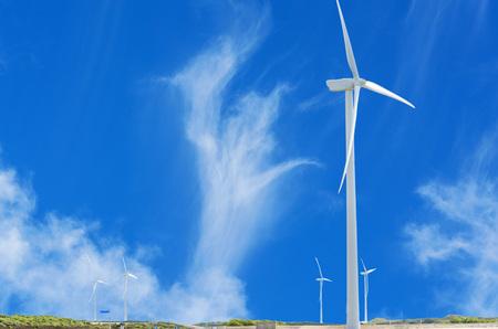 nonpolluting: Wind Turbine on the Dutch North Sea coast with blue sky. Stock Photo