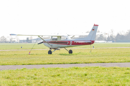 dysentery: Mhlheim, NRW, Germany - April 9, 2015: Small sports plane during startup at the airport Essen-Mlheim.