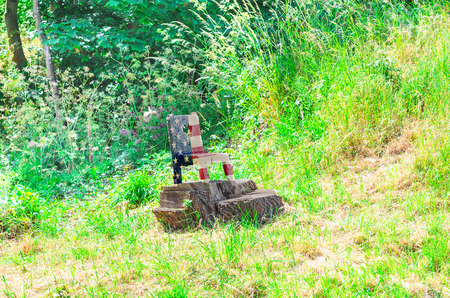 national colors: Small wooden chair cut from a tree stump in the national colors of the USA. Stock Photo