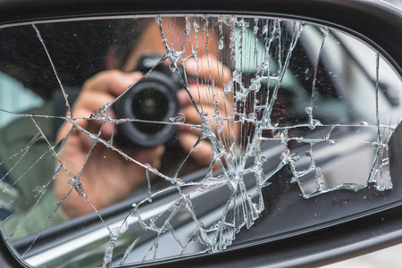 mirror image: Mirror image of a photographer in the broken car mirror