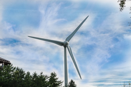 dramatic sky: Wind turbine for electricity production photographed from below against a dramatic sky. Stock Photo