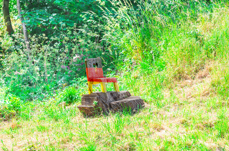 wooden chair: Small wooden chair cut from a tree stump in the national colors of Germany. Stock Photo