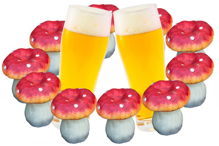 indulgence: Two beer glasses slightly inclined to each other and 10 fly agarics plastic Stock Photo
