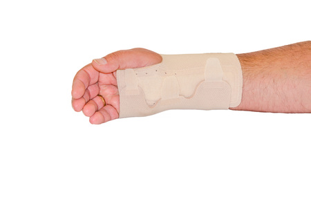 violence in sports: Injured male hand wrapped with Beige bandage for the wrist, isolated against white background. Stock Photo