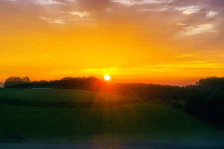 evening glow: Evening glow, beautiful reddish color of the evening sky at the low sun. Stock Photo
