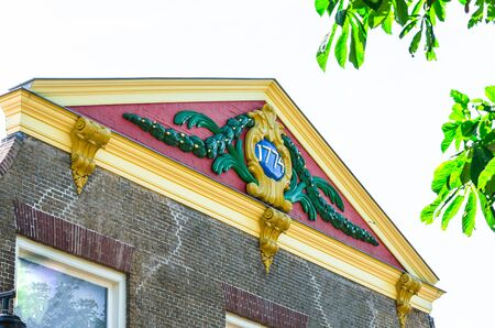 turn of the year: View of one beautiful old roof gable with the inscription year of construction 1774th