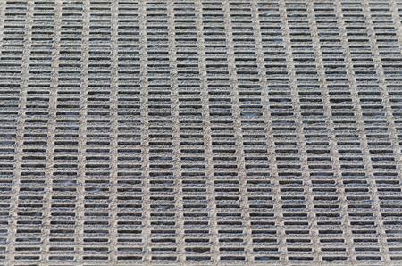 metal mesh: Gray perforated metal mesh background.