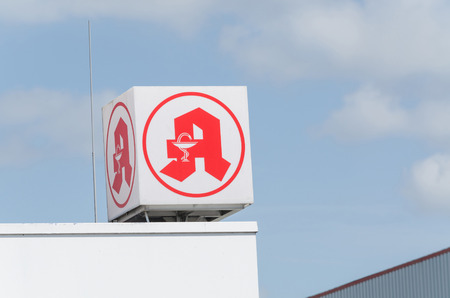 Ratinen, NRW, Germany - June 8, 2015: Advertising sign of a pharmacy in the building of the SB department store Gmbh Real in Ratingen.