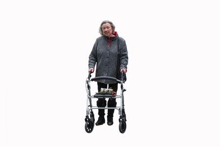 the great grandmother: Elderly lady with a walker against white background. Stock Photo