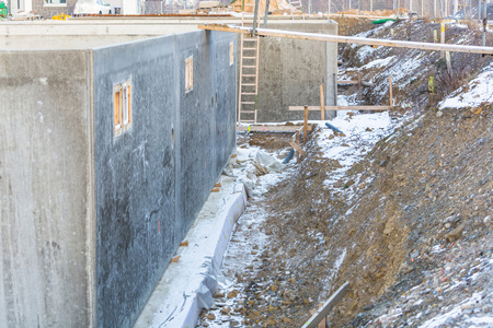 scaffolds: Construction, Structural work and foundations with excavation of a basement floor.