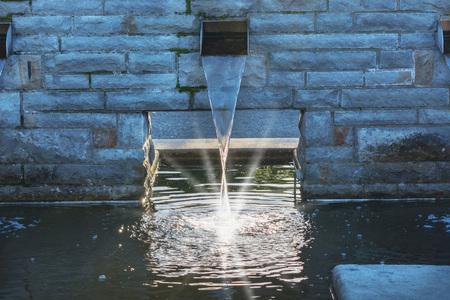 庭の池の水の供給。 写真素材