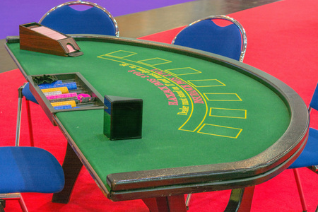 casino table: Casino table blackjack table with cards ready for playing.