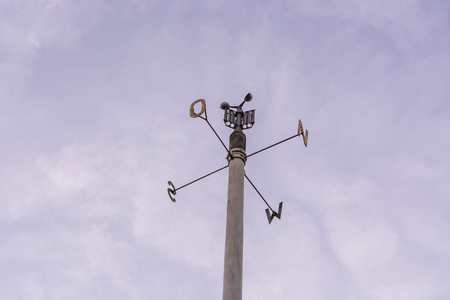 anemometer: Weather station with anemometer on blue sky.