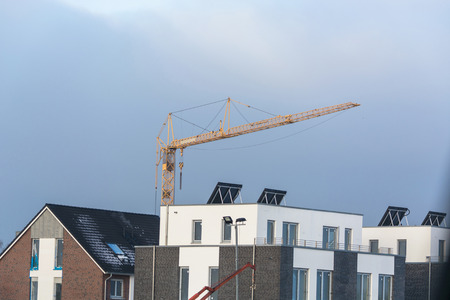 company ownership: Construction site, construction area with row houses and a crane. Stock Photo
