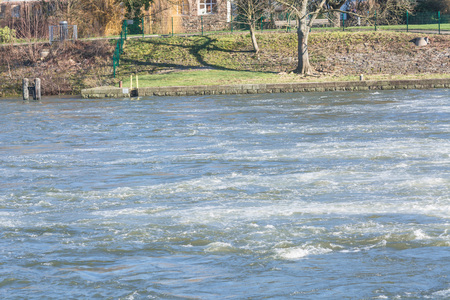 severe weather: Flooded embankment in heavy rain in Essen Werden in Germany.
