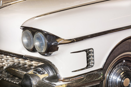 Holders, Nrw, Germany - February 1, 2016: Detail US car 50 years, headlight of a classic car at on exhibition in Haltern am See, Germany. Editorial