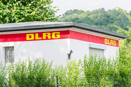 lifesaving: EAT, NRW, GERMANY - JULY 9, 2015: Renovated DLRG station at Baldeneysee Seaside Beach between Südtiroler Stuben and for the youth mission team of the German Lifesaving Society.