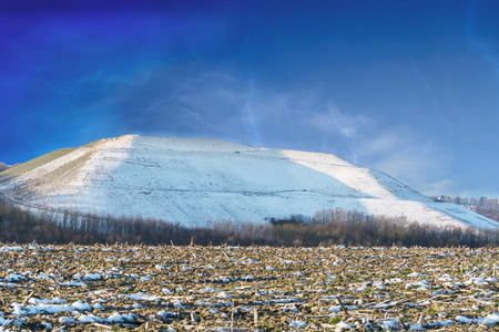 artificially: Snowy Mountain a landfill, dump in the winter.
